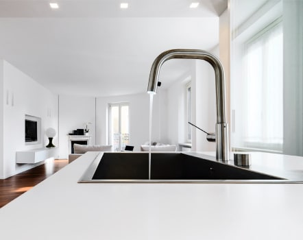 Guthrie Kitchen And Bath Faucet And White Counter